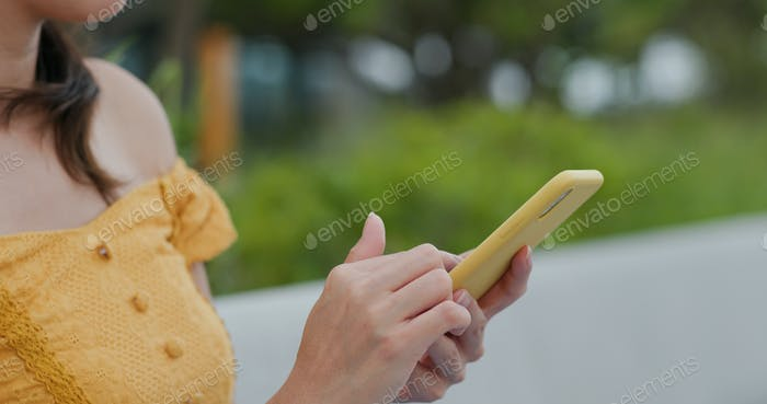 Young woman use of smart phone at park