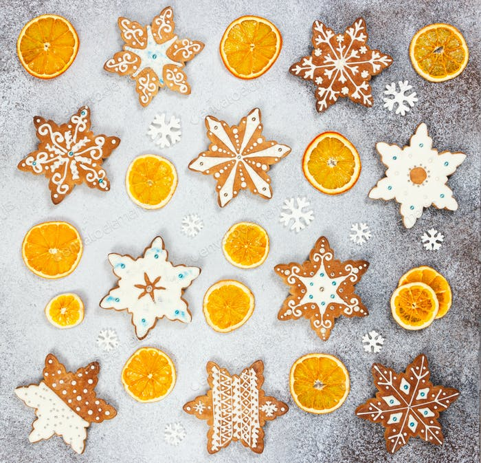 Christmas ginger cookies in the shape snowflakes and dried orange