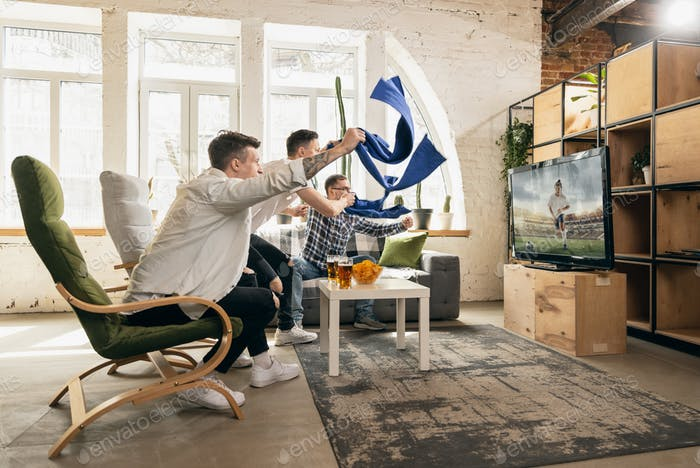 Group of friends watching sport match together. Concept of friendship, leisure activity, emotions