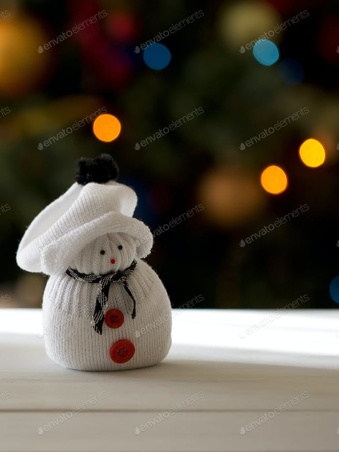 Snowman on a Christmas tree background