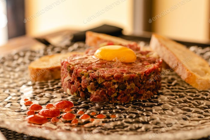 Steak tartar of old cow sirloin with 40 days of maturation on restaurant