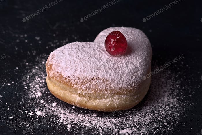 filled buns with heart shape, on dark background