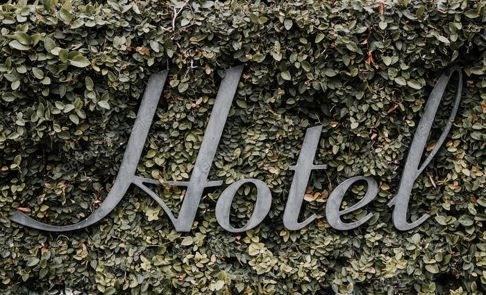 Hotel Sign in Vines