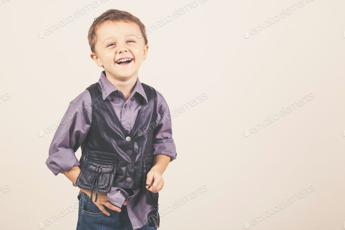 Cute little boy with sunglasses, isolated over white.