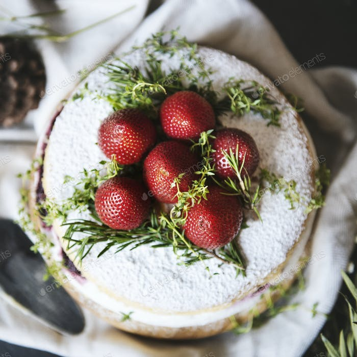 Layered cake with fresh cream and strawberries