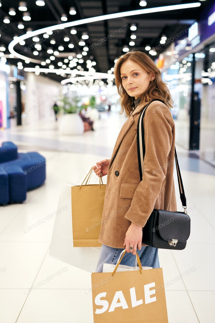 Attractive woman buying clothes on sale
