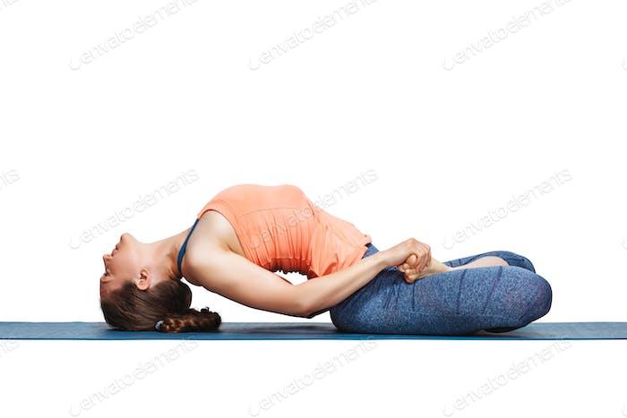 Beautiful sporty fit yogi girl practices yoga asana Matsyasana