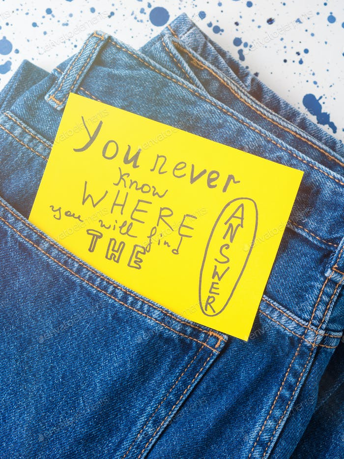 Jeans pocket closeup with inspirational quote