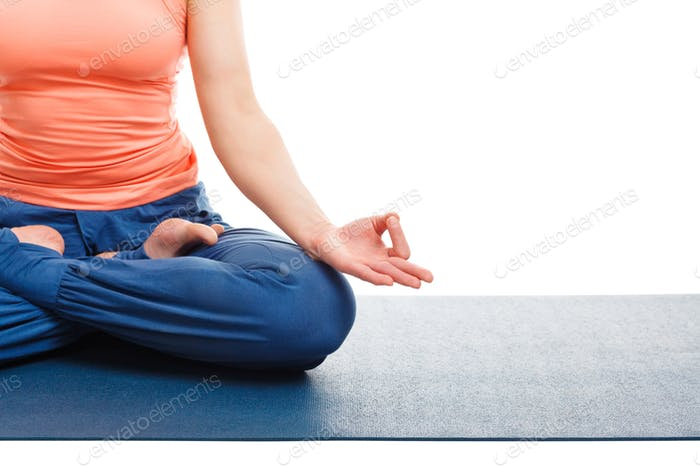 Close up of woman in yoga asana Padmasana Lotus pose