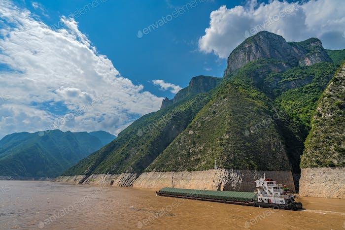 Cargo ship sailing through gorge on Yangtze River