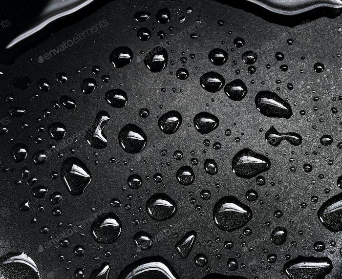 Water drops on the black floor