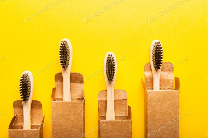 A family set of four wooden bamboo toothbrushes
