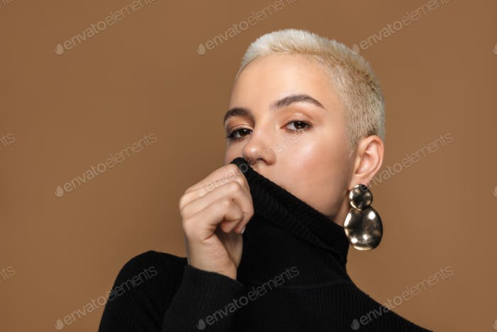 Portrait of an attractive sensual young blonde short haired woman