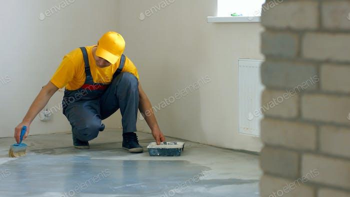 Worker making apartment renovation.