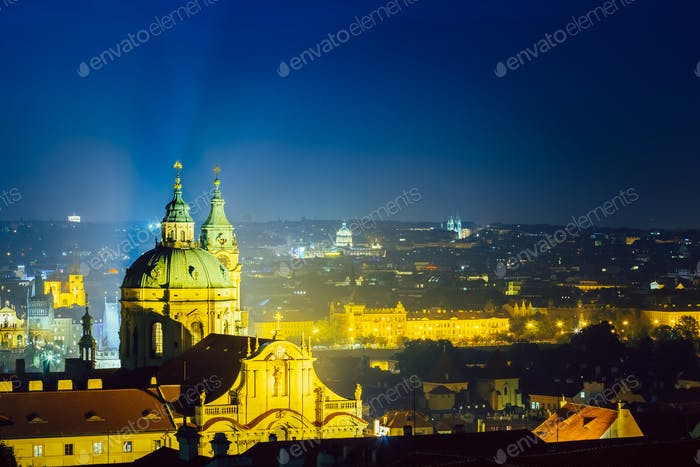 Night aerial view of cityscape and St. Nicholas Church in Prague