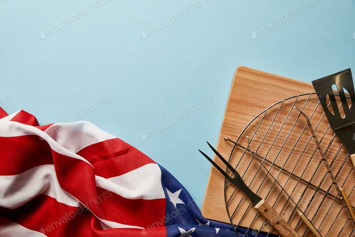 Top View of American Flag Near Bbq Equipment on Blue Background With Copy Space