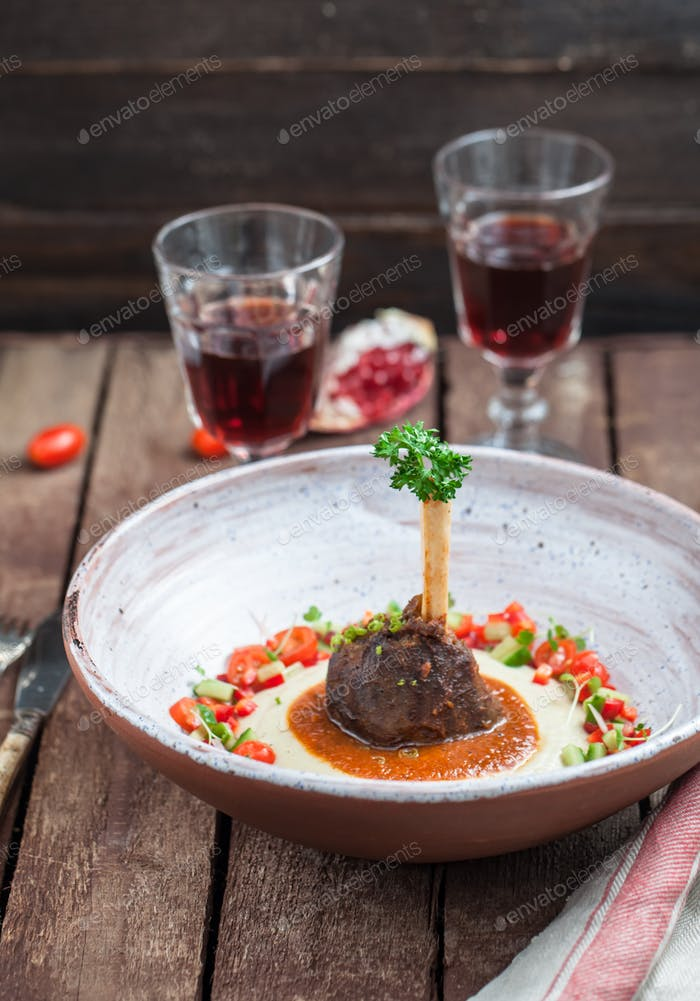 Lamb shank with eggplant puree, traditional turkish dish