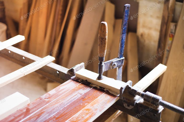 Carpenter gluing wooden planks