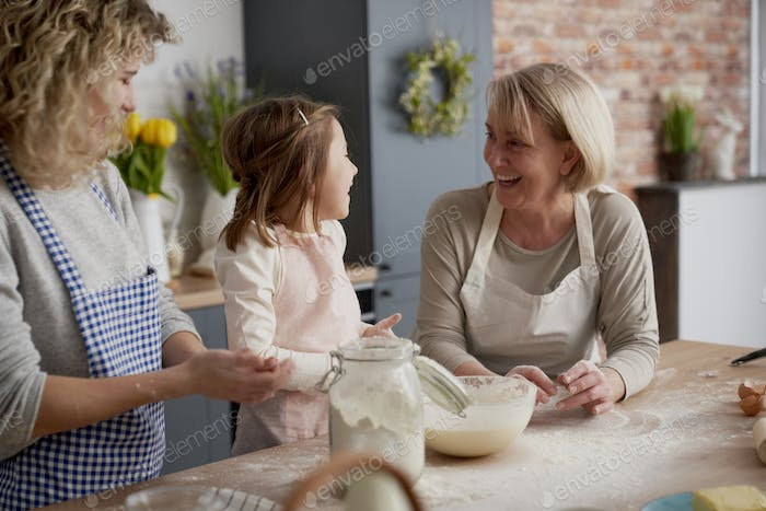 Happy three generations of women in the kitchen