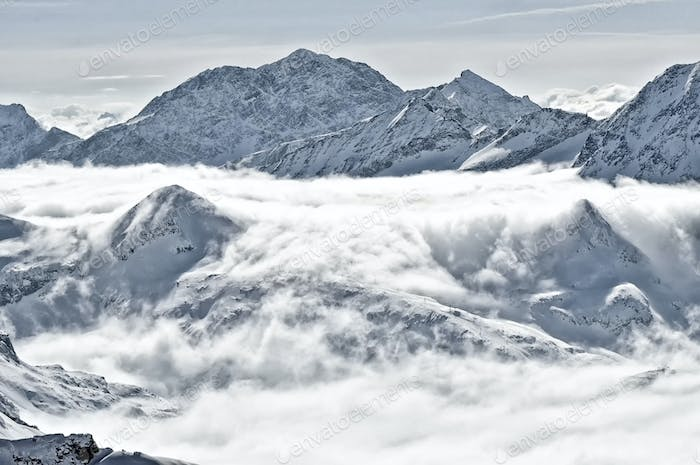Winter mountain landscape with clouds in the valley. Kitzsteinhorn, Austria