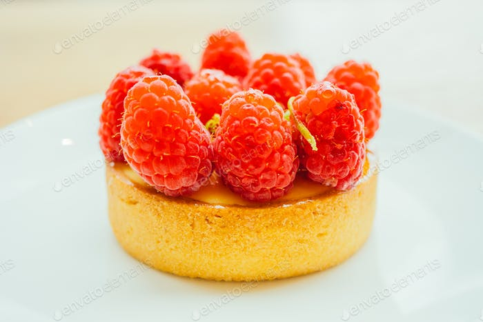 Sweet dessert custard tart with raspberry on top