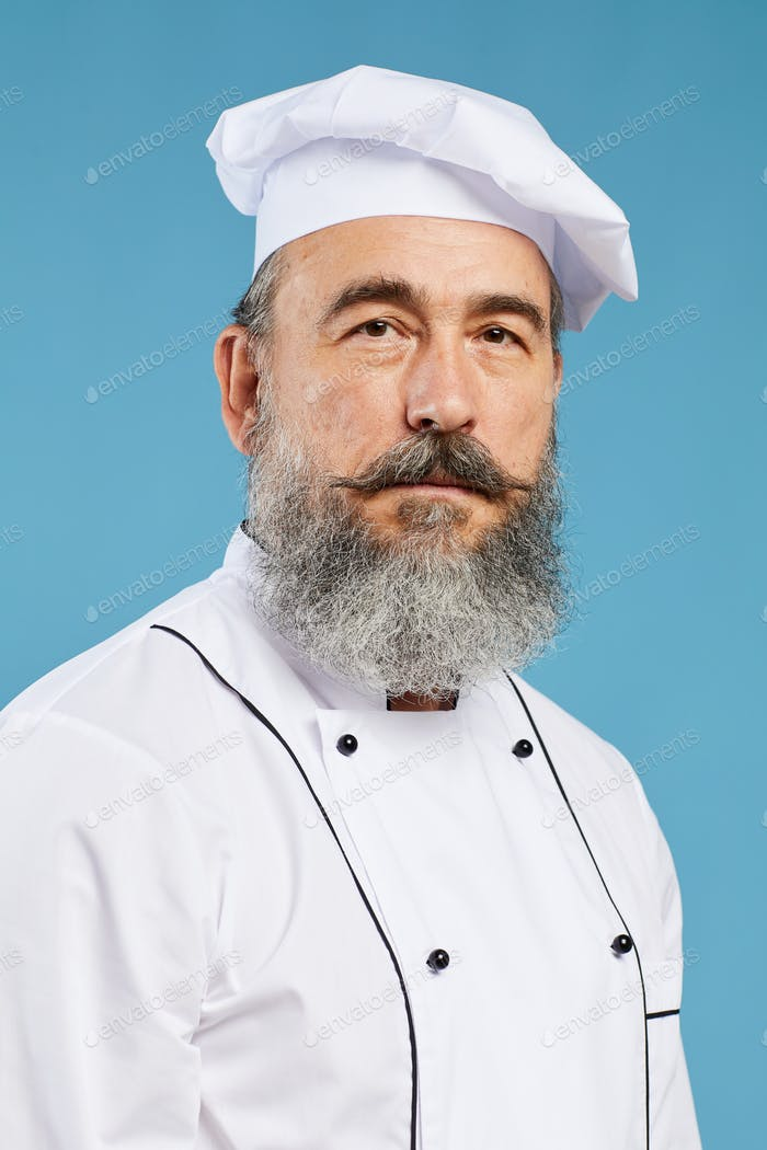 Portrait of Professional Chef on Blue