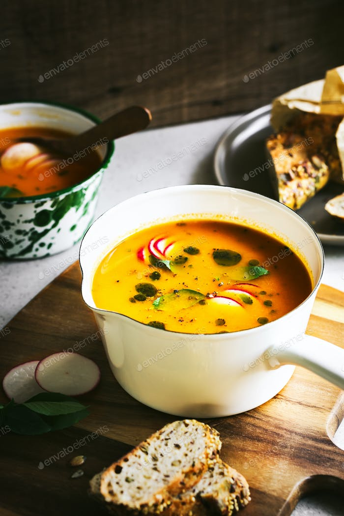 Carrot and Pumpkin soup with Basil oil by Multigrain seeds bread