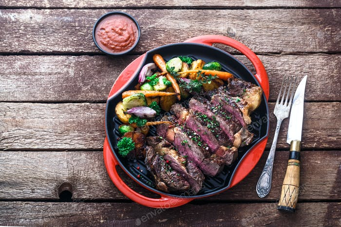 Grilled Beef Steak on grill iron pan, copy space