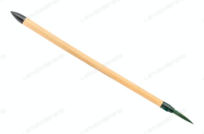 bamboo paint brush with green colored tip isolated
