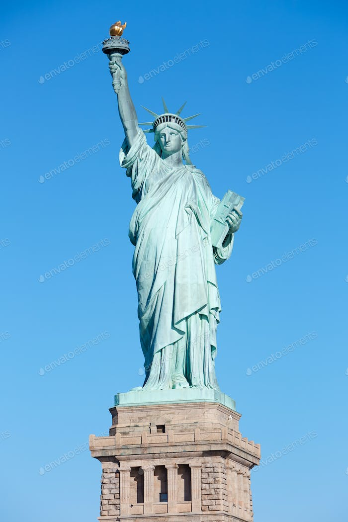 Statue of Liberty with pedestal in a sunny day in New York