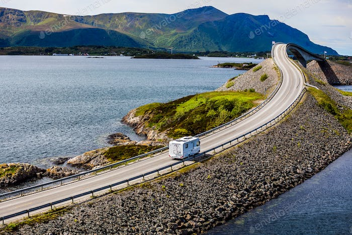 Caravan car RV travels on the highway Atlantic Ocean Road Norway