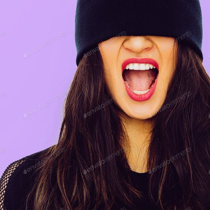 Screaming brunette Girl in black beanie. Fashion urban style