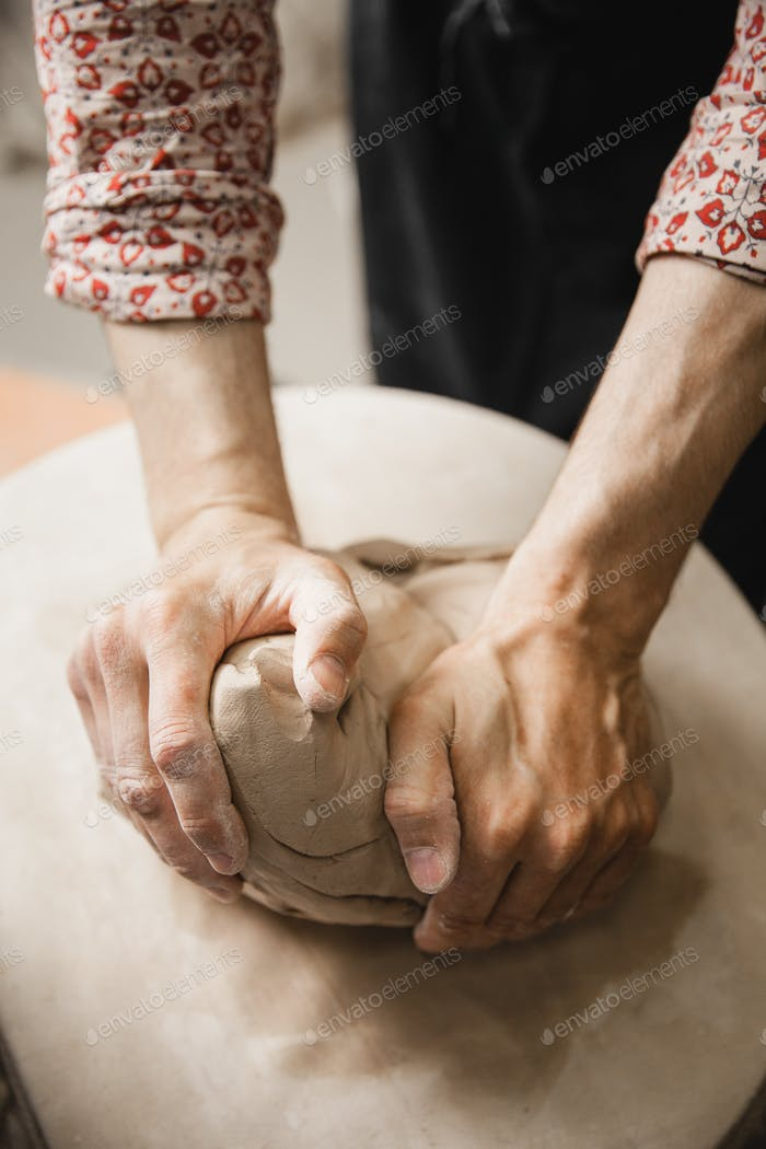 Potter master mashing the clay