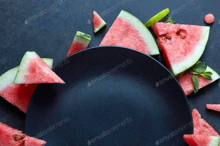 slices of watermelon placed near the plate black