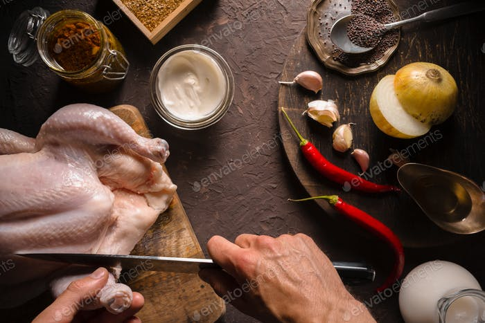 Preparation of chicken curry, chili and sour cream on the table. Indian food