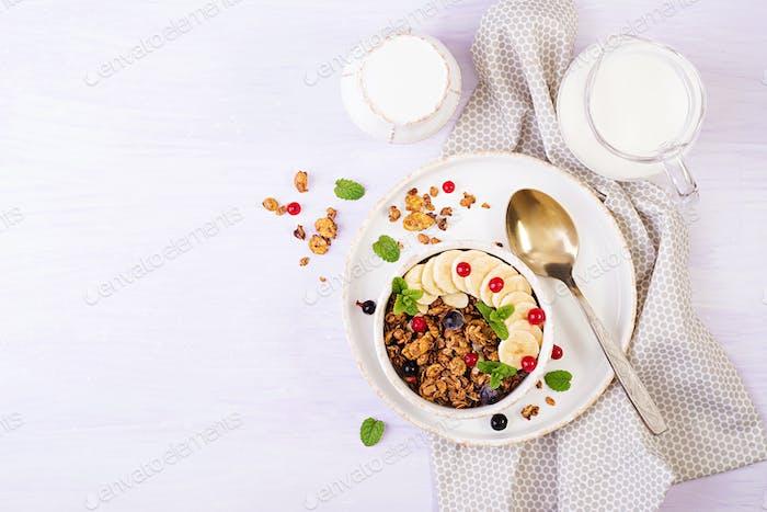 Breakfast. Bowl of homemade granola with yogurt and fresh berries.
