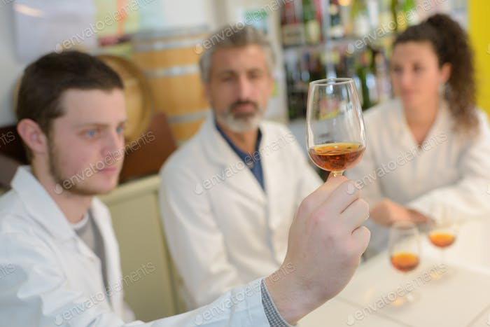 scientists studying chemical interactions in old alcohol