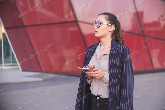 Woman hesitates to make a phone call. Doubt, indecision concept
