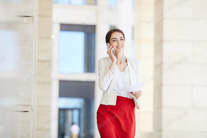 Beautiful Businesswoman Speaking by Smartphone