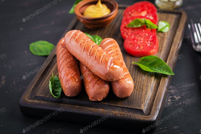 Grilled sausage with tomatoes, basil salad and red onions. BBQ menu.