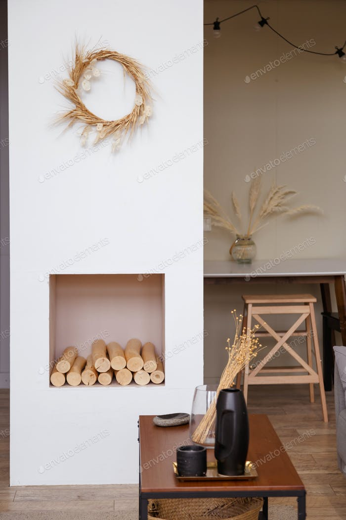 Modern interior design concept. Comfortable cozy living room wreath frame, fireplace
