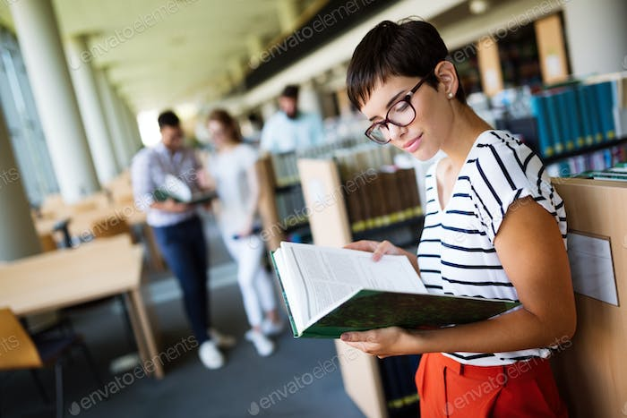 Woman reading a book at the library