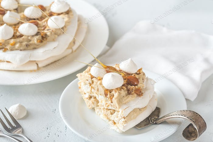 Pavlova cake with caramel and almonds