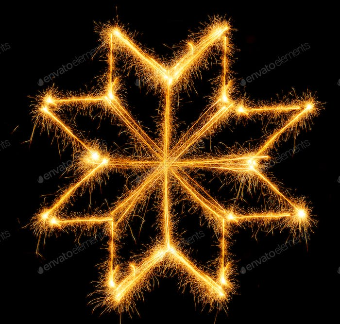 Snowflake made by sparkler on a black