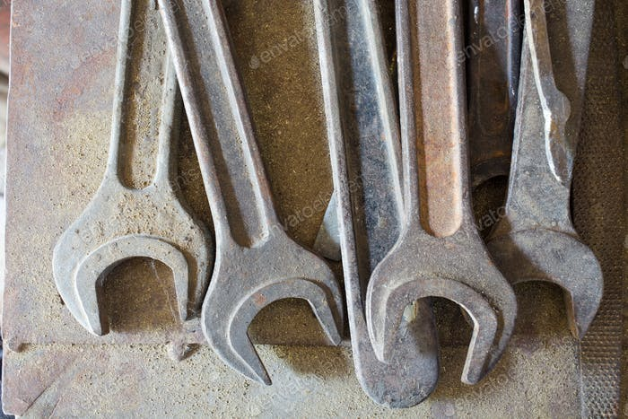Group of old metal wrenches.