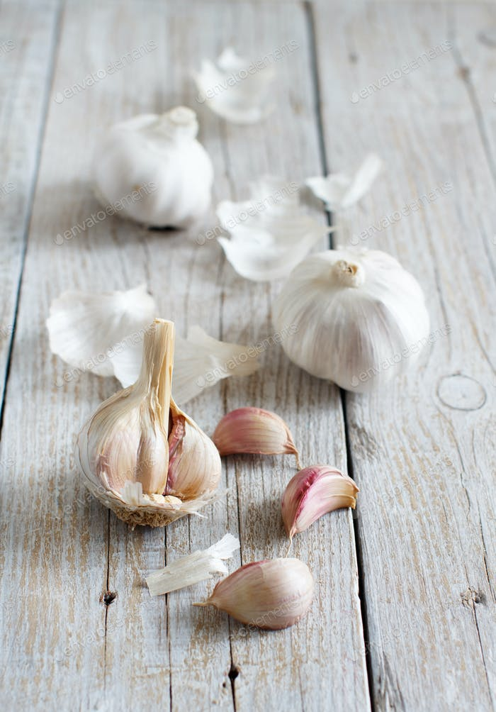 Organic garlic on wooden table