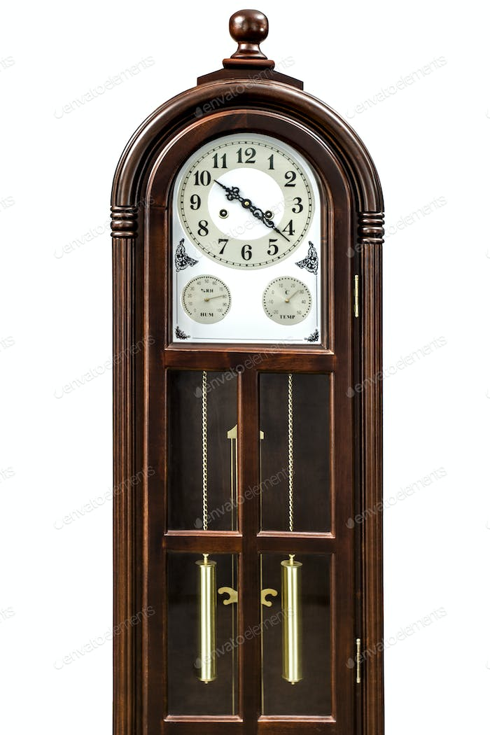 Antique clock with wood carved decoration, isolated on white bac