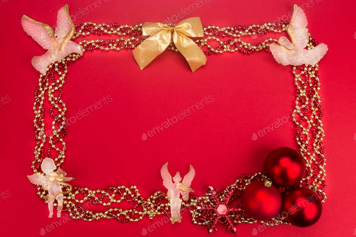 Beautiful ornaments framed Christmas decoration in red backgroun