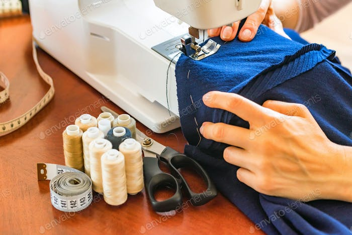 Dressmaker or seamstress works using sewing machine