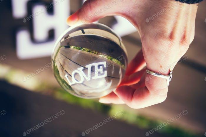 Love word view through a crystal ball